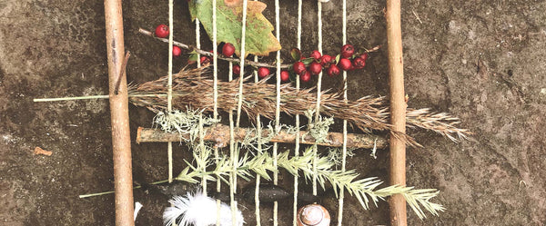 weaving natural objects including berries, feathers and shells- treasure from the foreshore in Pembrokeshire to make a woven piece of art