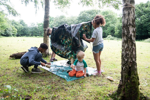 children build dens in  forest school outdoor play