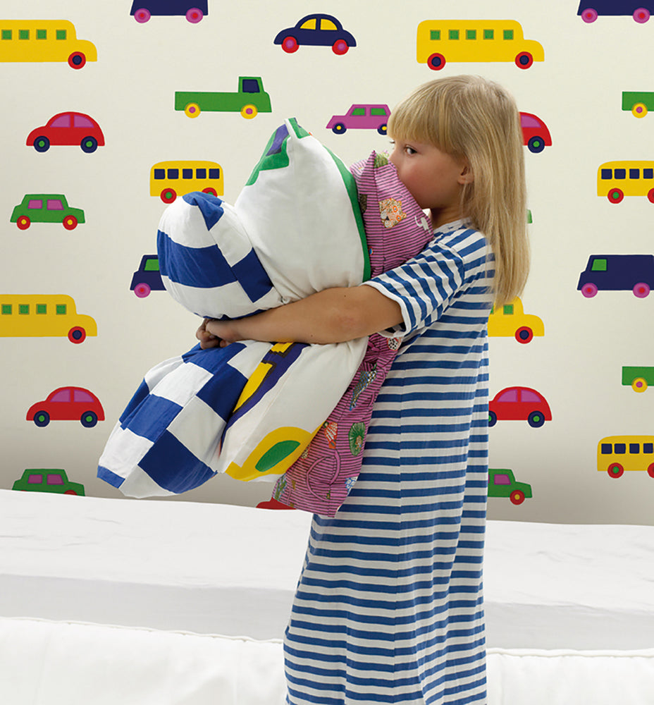 Young girl holding pillows with Marimekko Volume 5 Boboo Car Wallpaper