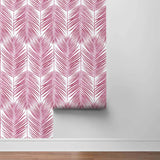 NW33001 cerise pink palm leaf peel and stick removable wallpaper roll by NextWall