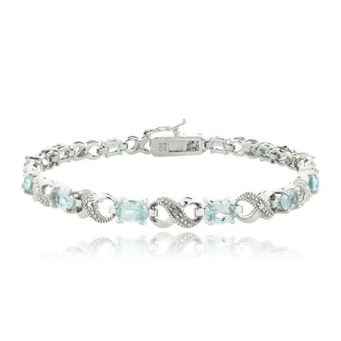 10.00 CT Genuine Blue Topaz Infinity Bracelet Embellished with Swarovski Crystals in 18K White Gold Plated - Clayton White