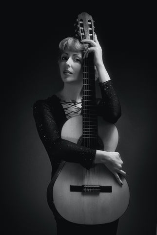 woman with a classical guitar