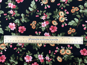 Ruler on fabric to show sizing of flowers.