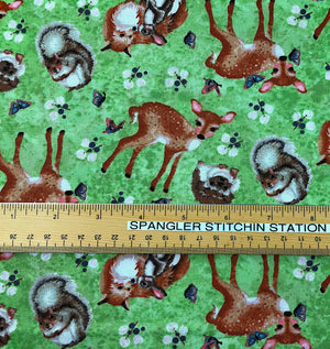 Ruler on fabric showing sizing of the wildlife.