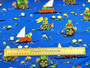 Ruler on fabric to show the size of the turtles and frogs.