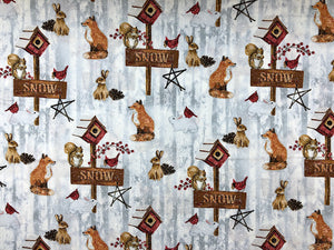 Snow covered fabric covered with Fox, Squirrels, rabbits and bird houses.