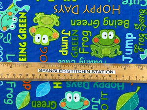 Ruler on fabric to show sizing of frogs and words.