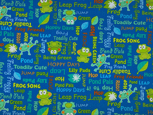Blue fabric covered with frogs and frog sayings such as hoppy days.