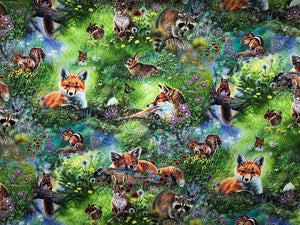 Fox, squirrels, raccoons and rabbits sitting or laying in a grassy meadow.