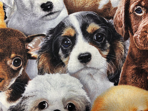 Close up of cotton fabric covered with dogs.