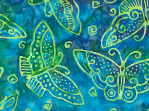 Close up of butterflies on blue and green batik fabric.