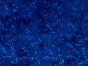 Blue batik fabric covered with dragonflies.