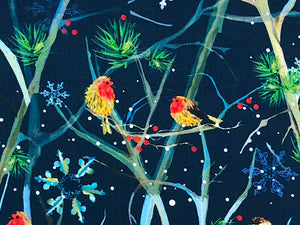 Close up of blue fabric covered with birds sitting on branches.