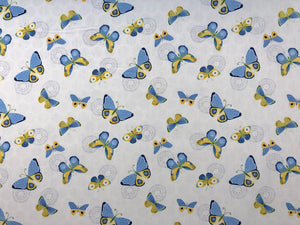 White Cotton fabric with blue and yellow butterflies scattered throughout.