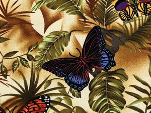 Close up of cotton fabric covered with leaves and a black and blue butterfly.