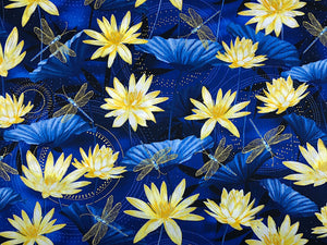 Blue cotton fabric covered with yellow water lilies and blue and gold dragonflies.