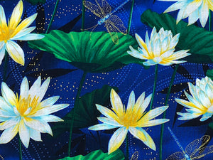 Close up of water lilies, leaves and dragonflies.