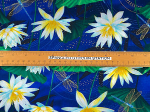 Ruler on fabric to show sizing of the water lilies and dragonflies.