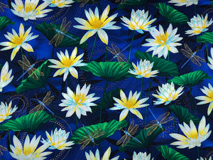 Blue cotton fabric covered with dragonflies and water lilies.