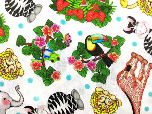 Close up of birds, frogs and other zoo animals on white cotton fabric.