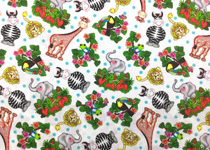 Cotton fabric covered with lions, zebras, birds elephants and more.