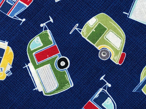 Close up of Blue fabric that is covered with travel trailers.