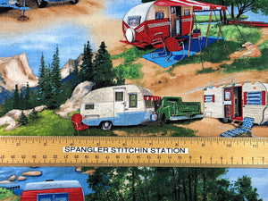 Ruler on fabric showing sizing of travel trailers.