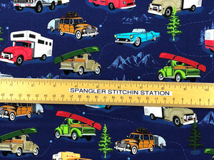Ruler on blue cotton fabric to show sizing of trucks and trailers.