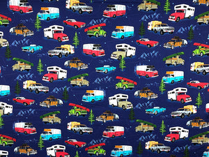 Blue fabric covered with vintage travel trailers, trucks and cars.