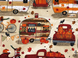 Close up of travel trailer and Truck full of pumpkins.