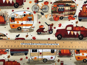 Ruler on fabric to show size of travel trailers and trucks.