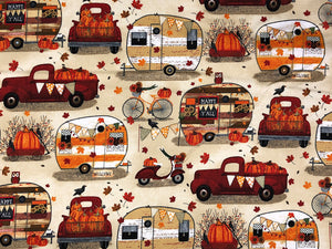 Cotton Fabric covered with travel trailers, trucks, pumpkins bicycles in a harvest theme.