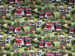Cotton fabric covered with travel trailers, dogs, chairs and pots of flowers.