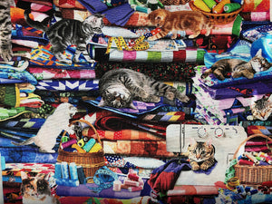 Close up of cats laying upside down on a quilt and cats sleeping.