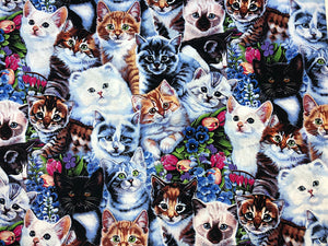 Cotton Fabric covered with kittens and flowers