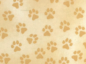 Close up of paw prints on a cream cotton fabric