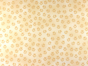 Cotton fabric covered in paw prints