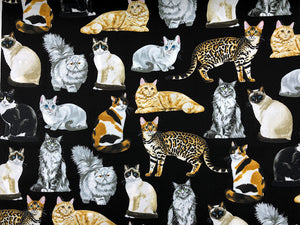 Black cotton fabric covered with realistic cats.