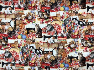 This fabric is called Sewing buddies and is covered with cats, sewing machines and quilts.