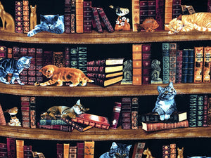 Cotton fabric covered with bookshelves full of books and cats.