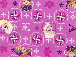 Pink cotton fabric covered with Disney Elsa and Anna.