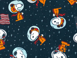 Close up of Snoopy wearing a space suit.