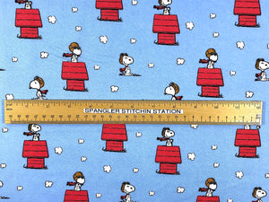 Ruler on blue fabric covered with Snoopy as red baron