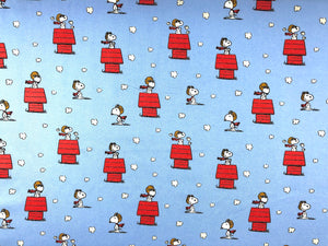 Blue fabric covered with Snoopy as red baron