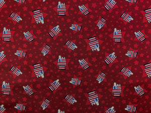 Red Cotton Fabric with Snoopy on top of his patriotic flag house.
