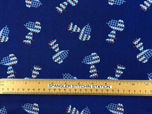Ruler on blue fabric that is covered with patriotic Snoopy