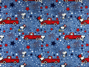 Blue cotton fabric with Snoopy celebrating  the 4th of July.
