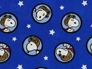 Close up of blue fabric covered with Snoopy as the Red Baron