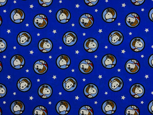 Blue cotton fabric covered with Snoopy as the Red Baron