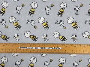 Ruler on fabric to show sizing of Snoopy, Charlie Brown and Woodstock.